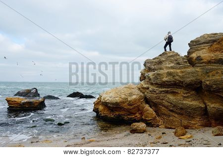 Traveller Standing On The Top Of Limestone Rock,odessa,black Sea,ukraine