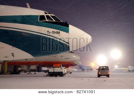 Moscow, Russia, February, 09,2015: commercial airplanes parking at the airport in winte