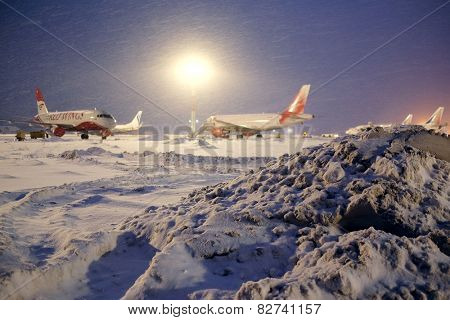 Moscow, Russia, February, 09,2015: commercial airplanes parking at the airport in winter