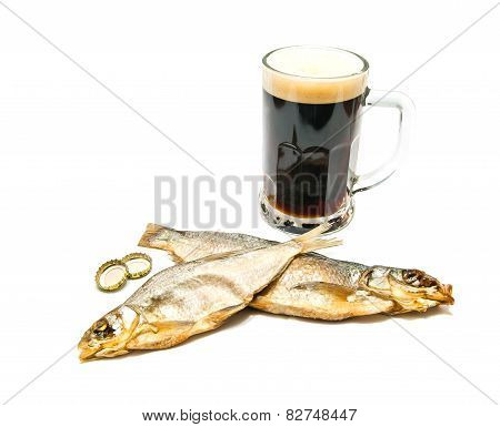 Salted Fish And Glass Of Dark Beer Closeup
