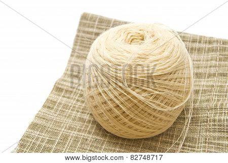 Tangle White Yarn On Fabric Closeup
