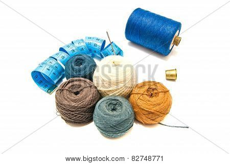 Balls Of Yarn And Metal Thimble