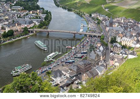 Aerial View Of Medieval City Bernkastel With Tourists Making A River Cruise