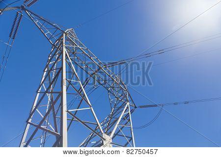 Electricity pylon against blue sky