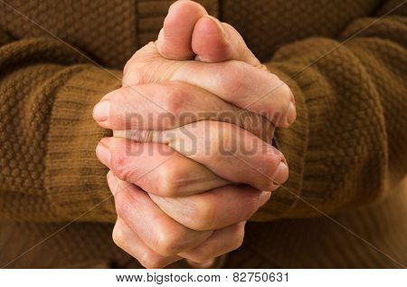 closeup shot of grandmother's hands praying