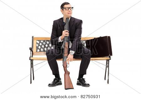 Desperate businessman ready to commit suicide isolated on white background