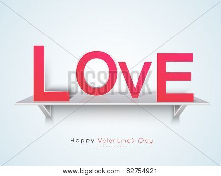 Pink paper text love on glossy wall shelf for Happy Valentines Day celebration.