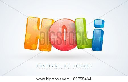 Indian festival of colors celebration with creative colorful text Holi on grey background.