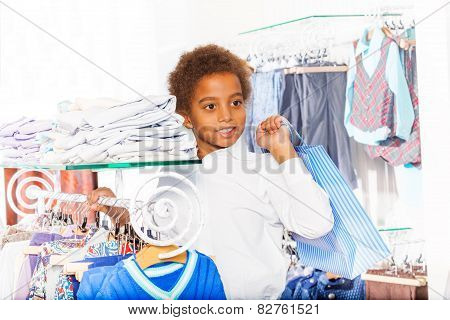 African boy with bag standing in the shopping mall