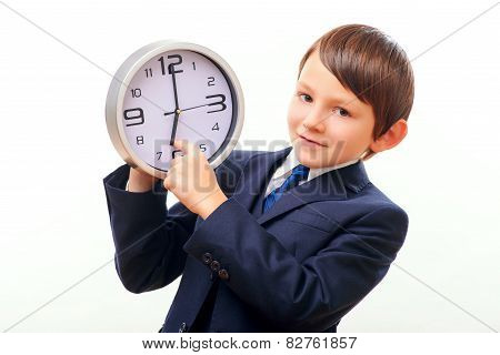Business child in suit and tie posing with clock