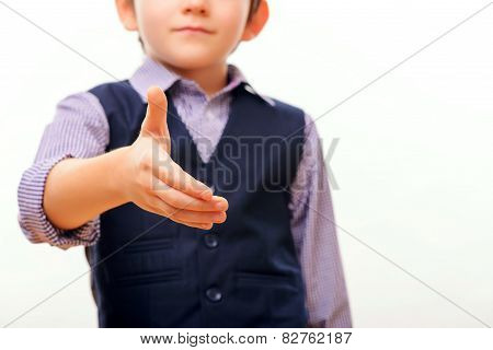 Cute child in suit stretching out hand