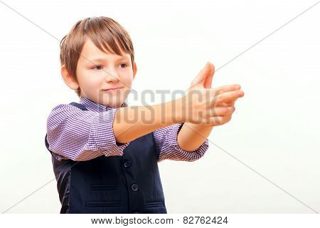 Cute schoolchild in suit with imagined gun