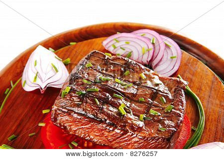 Beef Fillet Served On Wooden Plate