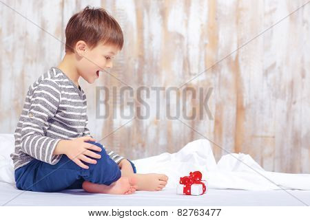 Portrait of a cute little boy in bed