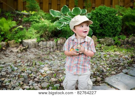 Happy Little Boy Holding Colorful Easter Eggs