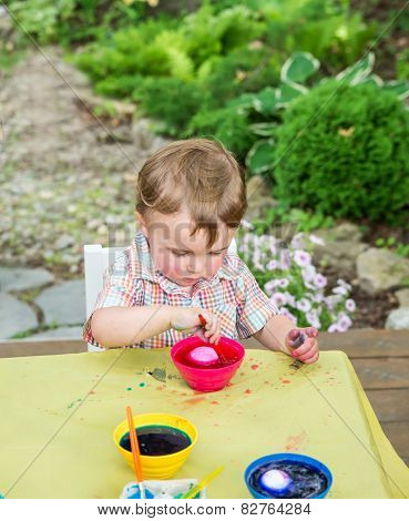 Boy Plays With A Easter Egg In Pink Dye