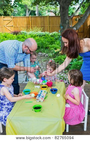 Family Dyes Easter Eggs Outside