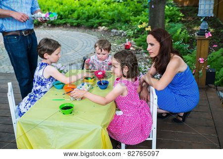 Children Dyeing Their Easter Eggs Outside
