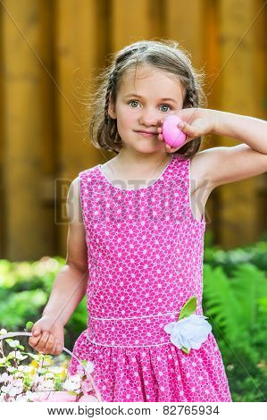 Girl Holding A Pink Easter Egg