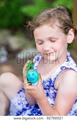 Little Girl Paints Her Easter Egg