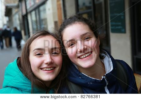 Happy Beautiful Student Girls On The Street