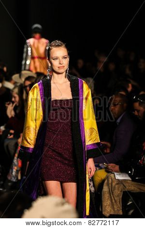 NEW YORK - FEBRUARY 13: A model walks the runway at the Mongol Fall/Winter 2015 collection during Mercedes-Benz Fashion Week in New York on February 13, 2015.