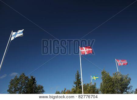 Nordic Flags On Dark Blue Sky