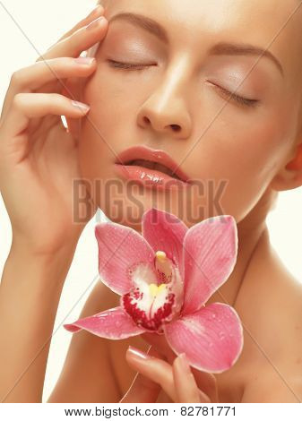 Beautiful girl with orchid flower.