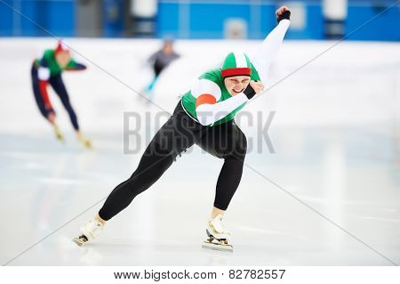 Speed skating male sportsman during competition race