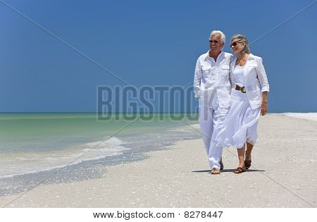 Happy Senior Couple Dancing Walking On A Tropical Beach