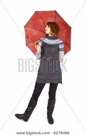 Young Beautiful Girl In Knit Dress With Red Umbrella Standing Isolated On White, Looking Left