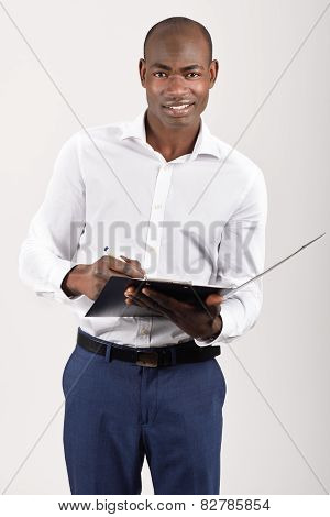 Black Man Wearing Casual Clothes In Black Background