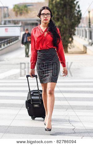 Hispanic Stewardess Crossing Street With Luggage Bags
