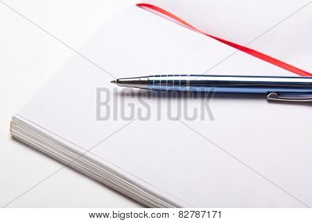 Open Note Book With Copy Space On Pages With Pen