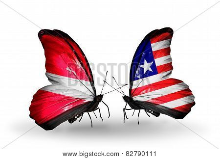 Two Butterflies With Flags On Wings As Symbol Of Relations Latvia And Liberia