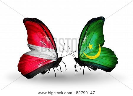 Two Butterflies With Flags On Wings As Symbol Of Relations Latvia And Mauritania