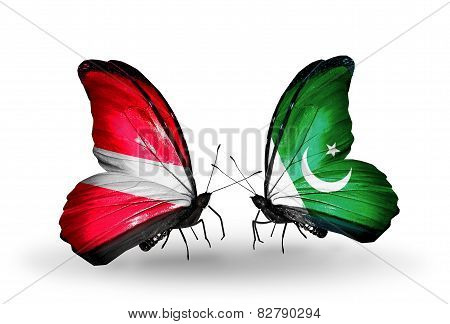 Two Butterflies With Flags On Wings As Symbol Of Relations Latvia And  Pakistan
