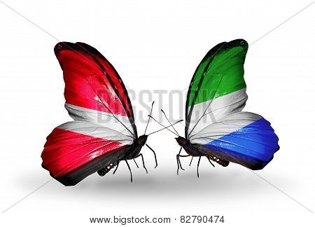 Two Butterflies With Flags On Wings As Symbol Of Relations Latvia And Sierra Leone