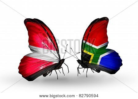 Two Butterflies With Flags On Wings As Symbol Of Relations Latvia And South Africa