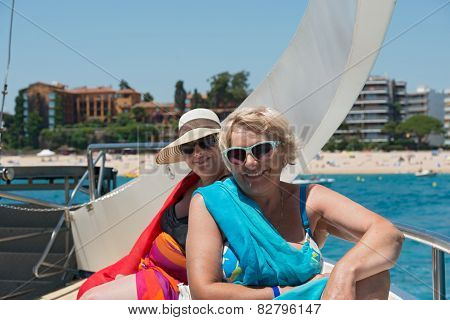 Women On The Deck Of Trimaran That Is Going Near Costa Brava Coastline.