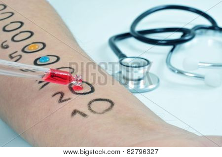 closeup of the arm of a young man who is having a skin allergy test