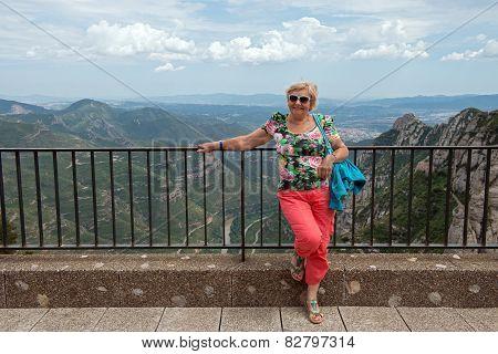 Aged Woman On  Llobregat Valley Background, Montserrat, Catalonia, Spain.