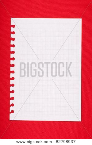 Torn blank lined notebook page on red background