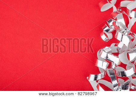 Silver strands on red background