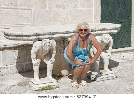 Woman Posing For Imitating The Memorial Sculptures.