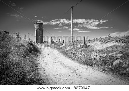 country road, blue sky, ancient overhead water tank reserve