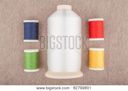 Coloured spools of thread