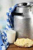 image of milk products  - Retro can for milk with fresh bread and glass of milk on wooden table - JPG