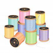 stock photo of bast  - Silver needle and 12 spools of thread in pastel colors isolated on white background for sewing - JPG