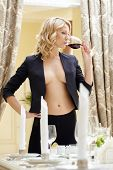 image of topless  - Beautiful topless blonde drinking red wine in restaurant - JPG
